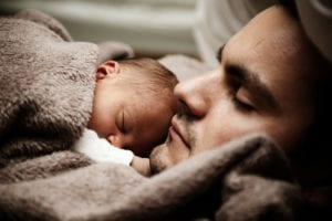 photo of man and baby sleeping