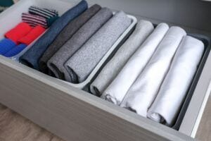 Clothes storage in the dresser cabinet using the KonMari way