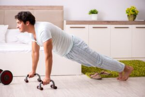 Man doing Push-Up Resistance Training Prior to Sleep for Weight Loss - Simply Good Sleep